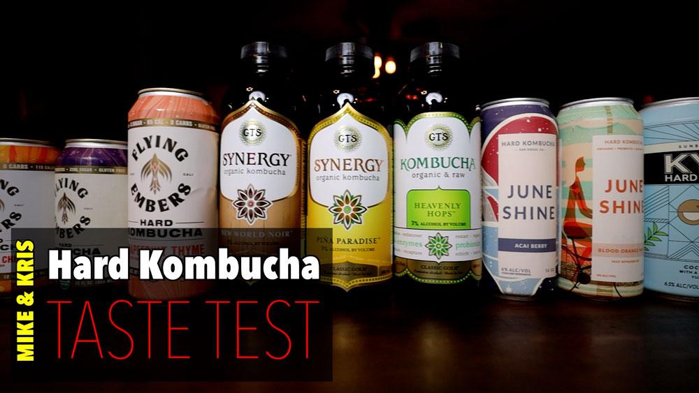 bottles of hard kombucha lined up on a bar